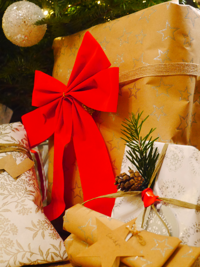 Red bow and gifts under tree