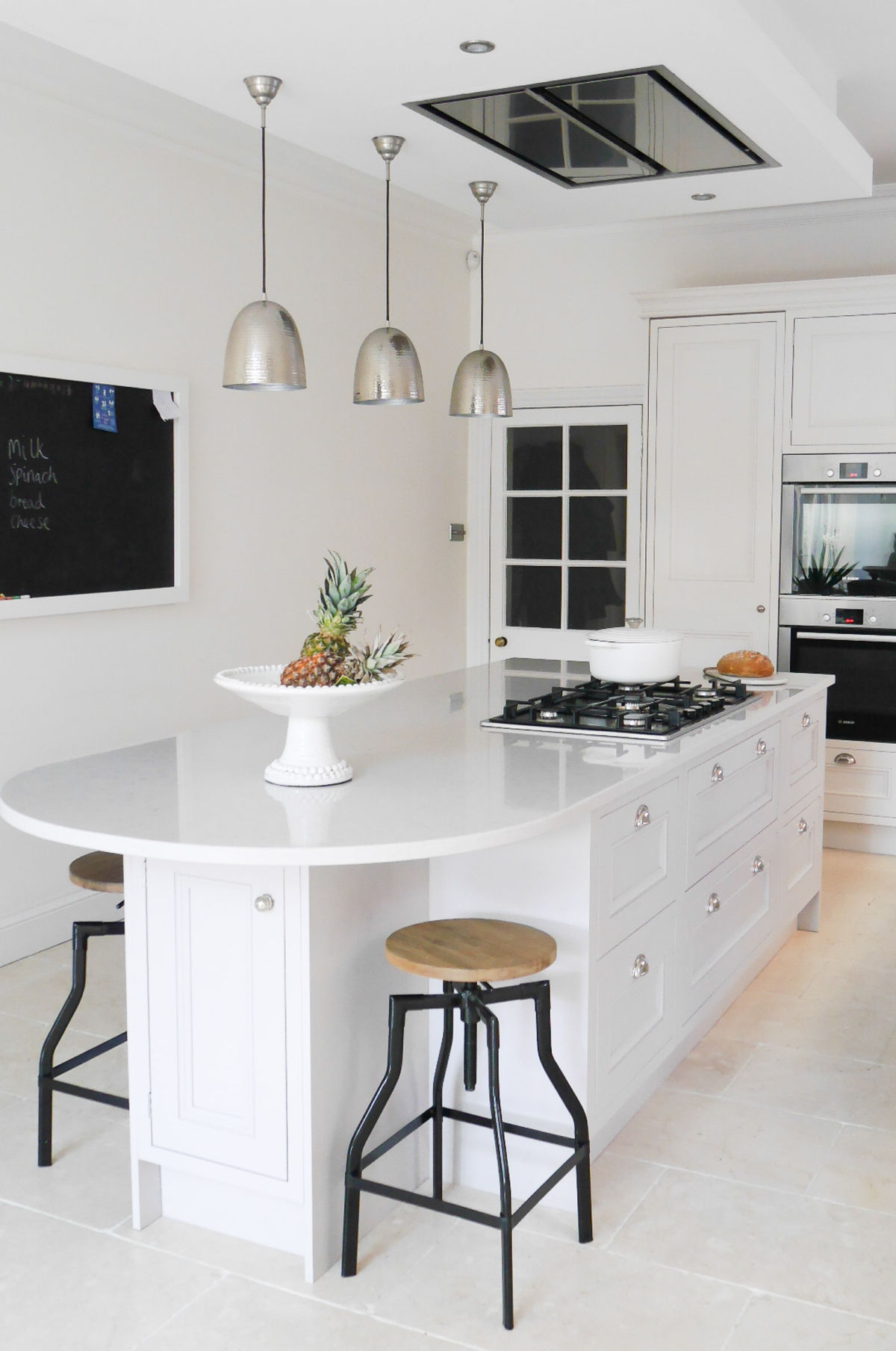 Bright white kitchen design and Scandi inspired living area