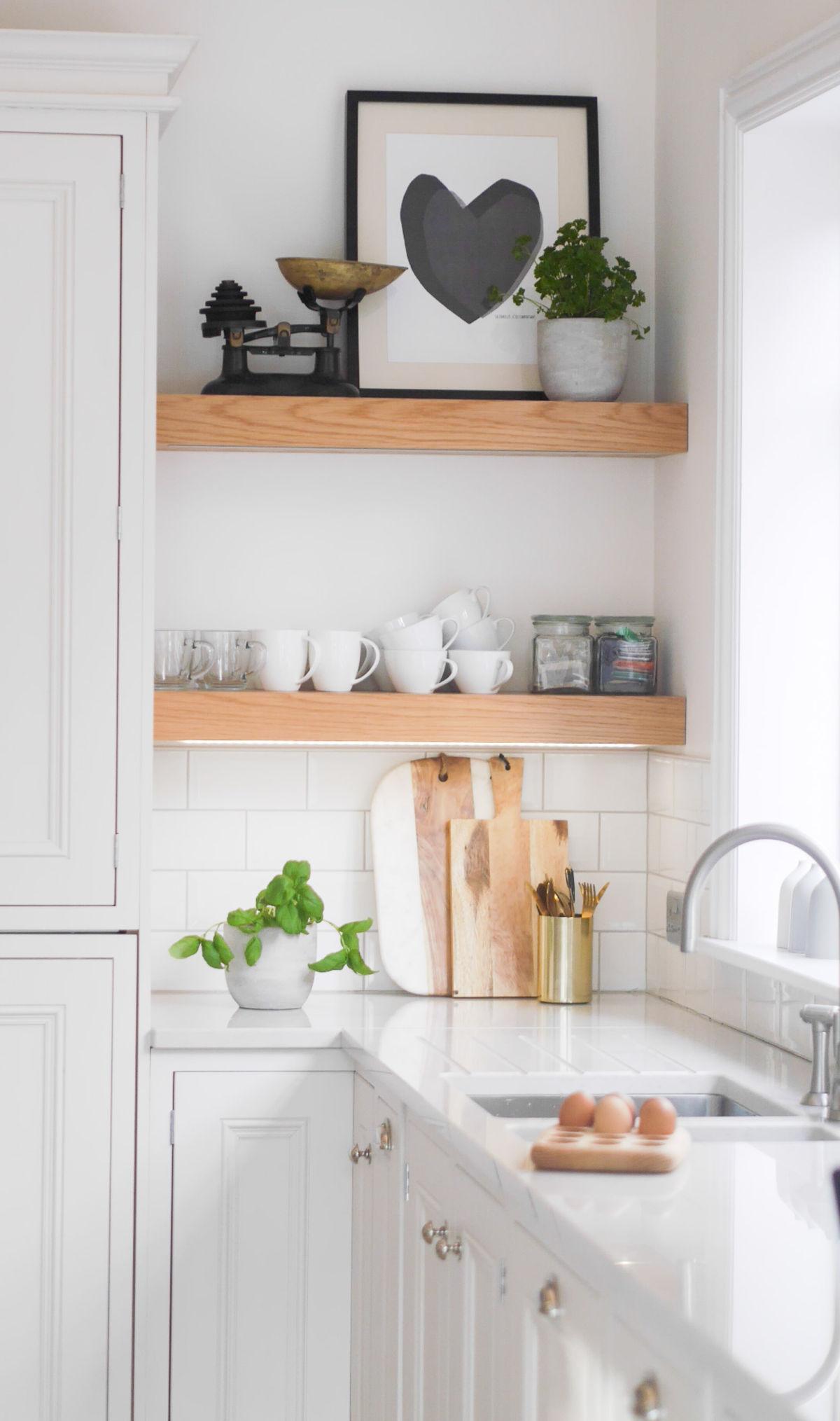 Bright white kitchen design and Scandi inspired living area