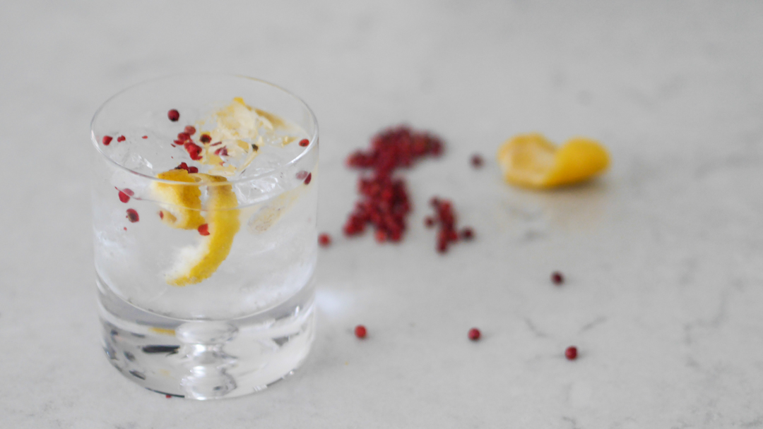 3 ways to elevate your everyday gin and tonic - lemon peel and pink pepper pod