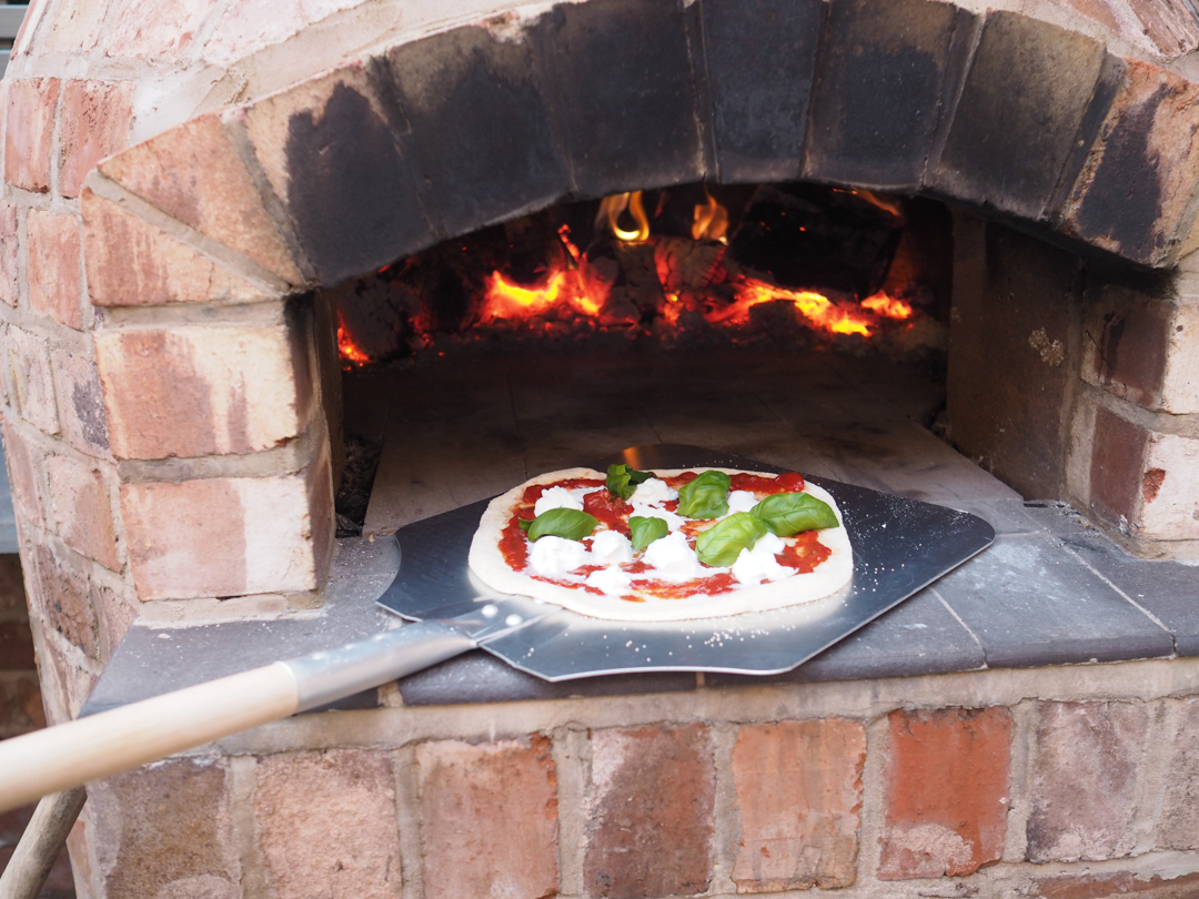 Making fresh pizza in our Pizza oven