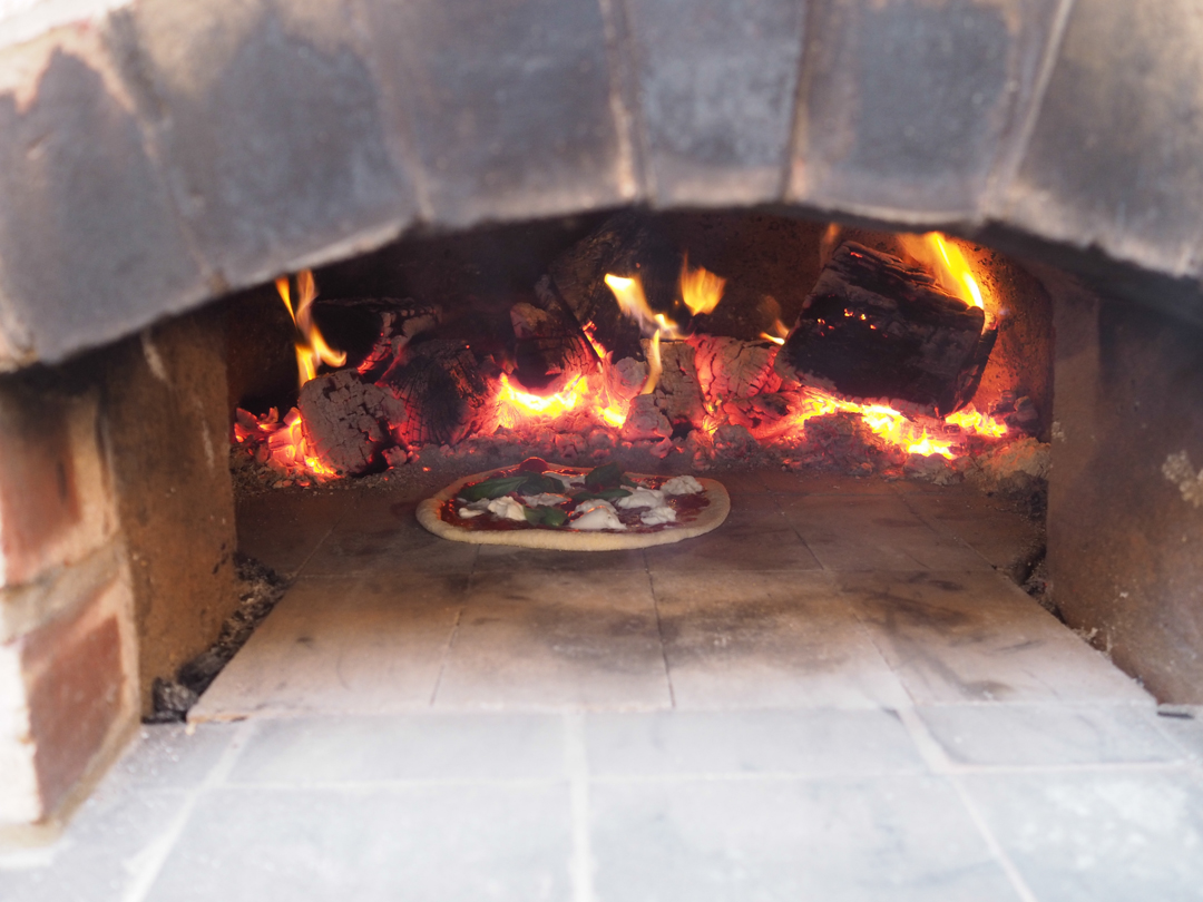 Pizza in the wood fired pizza oven